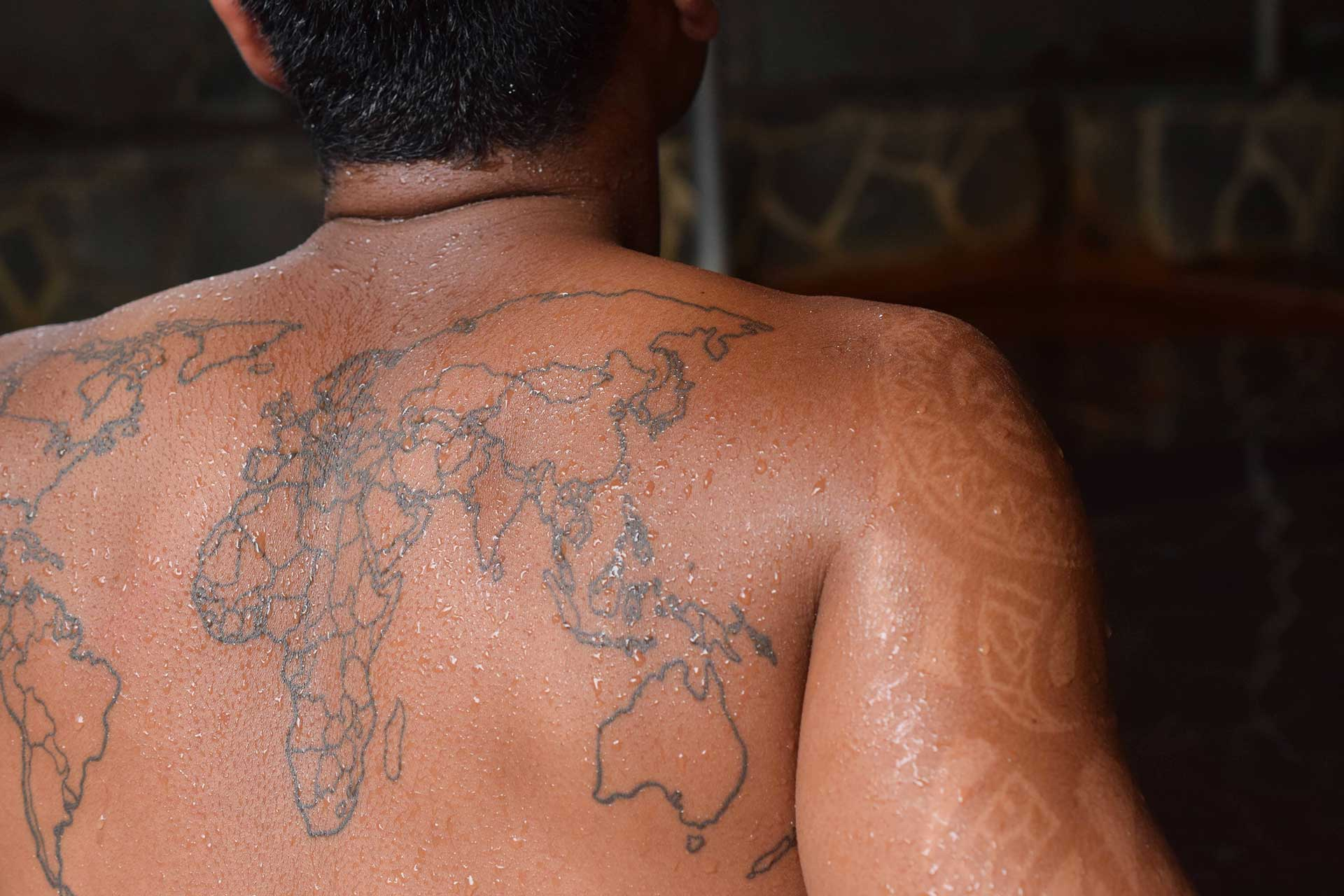 man with tattoo at Beppu Japanese hot spring in tattoo friendly onsen